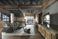 Chalet Edelweiss Courchevel 1850 master bedroom lounge with TV and sofas