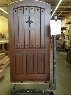 Custom Wood Gate with Raised Panels, Clavos, and Carving