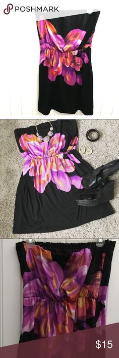 Black strapless dress Gorgeous black strapless dress with large flower of purple, orange , red and yellow , on front and back ( back pretty much identical to front ) rock this with some wedges or sandals for a casual look ! Or can be dressed up with a heel and even used as a swim cover up . #floral #straplessdress #blackdress #coverup #datenight #vacation Maurices Dresses Strapless