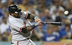San Francisco Giants' Pablo Sandoval hits a RBI single in the sixth inning of a baseball game against the Los Angeles Dodgers in Los Angeles, Monday, Aug. 20, 2012
