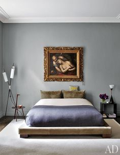 An ornately framed 18th century Italian painting hangs in Stefano Pilati's Paris bedroom. Photo by Björn Wallander for Architectural Digest.