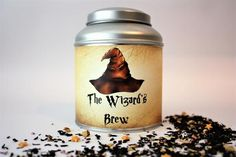 The Wizard's Brew Tea Caddy Gift - Harry Potter Inspired Tea One of our Harry Potter inspired tea gifts. Using our popular domed tea caddy, we have blended a black tea with vanilla and licorice, then added a special touch of gold stars which will slowly disappear before you very eyes. now that is what we call magic! With 100g of tea and a resealable inner lid this makes a great present.