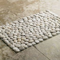 Black River Stone Mat - Made from river stones, this bathmat massages the feet, adding the natural element of rocks to the bathroom. Let you...