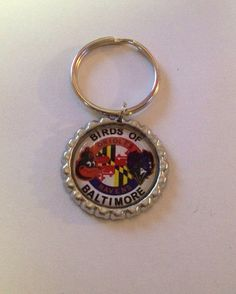Handcrafted Ravens/Orioles Birds of Baltimore Themed Flat Bottle Cap Keychain on Etsy, $3.00