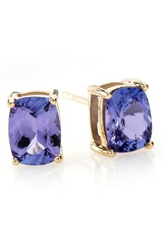 Tanzanite, you've done it again. You've stolen our hear and we aren't even mad! With studs like this to wear around town, how could we be? | 2.70ctw Cushion Tanzanite 10k Yellow Gold Earrings