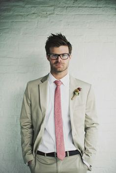 Offbeat stylish groom in beige suit & pale pink tie (wouldnt go for pink myself, another colour, like light blue)