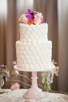 elegant wedding cake with fresh flowers incorporated in the design