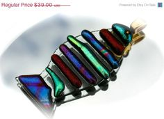 This is a truly beautiful, fun, colorful piece of art. This fish is just adorable. Dichroic glass is one of the most beautiful mediums to work