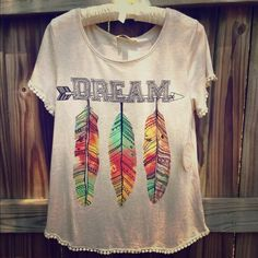 "Feather graphic T-shirt Boho style ""dream"" graphic tee with 3 colorful feathers. The sleeves and bottom of the shirt have a cute fringe. Tops Blouses"