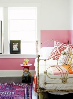 bedroom, twin bed, iron frame, boho pillows, pink/white wall, Turkish rug