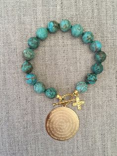 "TURQUOISE hand-knotted BRACELET with a 14k gold filled ""Padre Nuestro"" prayer charm by Somanci on Etsy"
