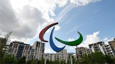 The ParalympicAgitosare displayed in the Paralympic Village ahead of the Games. Thesymbol iscoloured red, blue and green to represent the three colours most widely used in flags around the world.