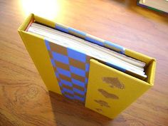 homemade book with a magnet-locked flap