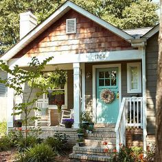 Go Whimsical in Your Color Approach. Teal front door and gray grey exterior on house home. (IDEA for front porch):