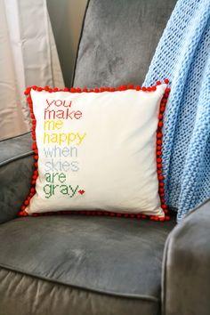 Make a DIY cross stitch pillow