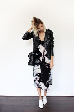 Black jacket over print dress