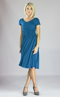 Modest Dresses: Lilian Dress in Blue Sapphire  This soft, blue jersey number has effortless charm. The gentle pleating and gathered detailed waistline accentuate and flatter, while the classic short-sleeves and modest v-neckline make this piece easy to wear casually or dress up. Don't be surprised when the compliments come rolling in while wearing the Lilian dress!