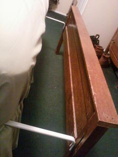 To use a footboard that does not fit or connect to your bedframe, just attach the two halves of a standard curtain rod to the sides and slide them between the mattress and box springs. Easy to move for making the bed too. =)