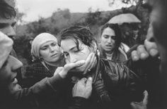 1998: A woman is comforted by relatives and friends at the funeral of her husband. The man was a soldier with the ethnic Albanian rebels of the Kosovo Liberation Army, fighting for independence from Serbia. He had been shot the previous day while on patrol. (By Dayna Smith)