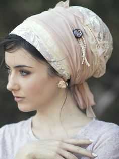 For some reason, I am in love with tichels. I'm not Jewish, but I love the idea of hair covering. She just looks so regal.