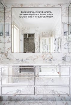 Carrara marble, mirrored paneling, and gleaming chrome fixtures strike a luxurious tone in the suite's bathroom | domino.com