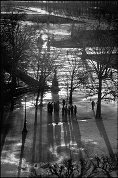 The Jardins des Tuileries gardens. Paris, 1976.    by Henri Cartier-Bresson