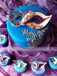 Masquerade party cake and matching cupcakes
