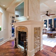 double-sided fireplace.  wood trim around the stone...