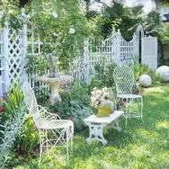 Trellis Design Ideas: Trellises with Fences or Screens Trellis Fence The swooping lines of the latticework fence and arbor seen here reflect the curves in the landscaping, furniture, and decorative stone balls. Wooden Trellis, Arbors Trellis, Diy Trellis, Trellis Ideas, White Trellis, Privacy Trellis, Yard Privacy, Trellis Design, Pergola Design