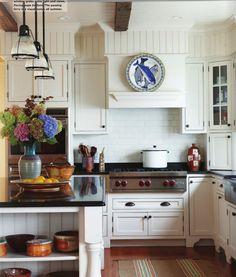 New England Home Magazine-Beautiful White Kitchen - love that blue fish platter!