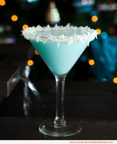 coco snowball cocktail | 2 ounces Stolichnaya Vanilla 2 ounces Malibu rum 2 ounces Coco Lopez ¼ ounce Blue Curacao Directions: Shake well and pour into a martini glass. Rim glass with honey and fresh shredded coconut.