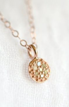 Tiny pave diamond and rose gold disc necklace. By Kahili Creations of Hawaii...