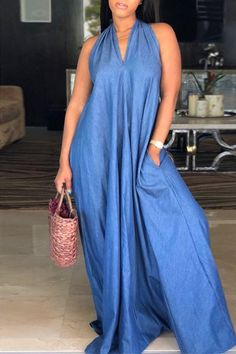 Add the finishing touch to any outfit with this flattering dress. This is a plain, sleeveless, halter neck, tent dress. This long dress is made from polyester Denim Maxi Dress, Maxi Dresses, Long Dresses, Bridesmaid Dresses, Ethno Style, Tent Dress, Flattering Dresses, Floor Length Dresses, African Fashion