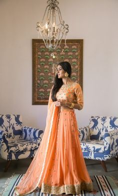 Light Lehenga - Bride in a Peach Lehenga with Golden Detailing | WedMeGood | Outfit by: Bhumika Grover #wedmegood #indianbride #indianwedding #bridal #lehenga #indianlehenga #peachlehenga #golddetailing #peach #light