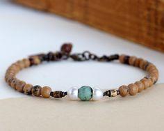 Etsy listing at https://www.etsy.com/listing/462106307/rustic-stone-bracelet-brown-bead. $26.