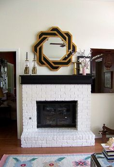 Beautiful Painted Brick Fireplace, like how they painted the mantel a different color than the rest of the brick....