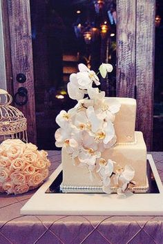 The couple had a two-tier traditional Mexican tres leches cake covered with vanilla fondant. Fresh white phalaenopsis orchids cascaded down the cake to give the delectable treat a refreshing romantic touch.