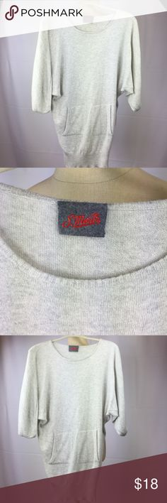 ST. MORITZ Sweater Dolman sleeves. The Length is 29 inches. Well made in good condition. St. Moritz Sweaters