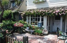 """I love """"cottage style gardening""""!  Anyone can do this on their deck or patio~~~so inviting to say """"Come stay a while"""""""