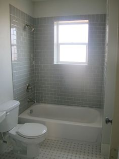 Suzie: White & Gold Design - Fantastic guest bathroom with with 3x6 Desert Gray subway tile ...: