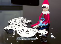 Elf on a Shelf - Antic: Cut up a bunch of snowflakes for us to hang up