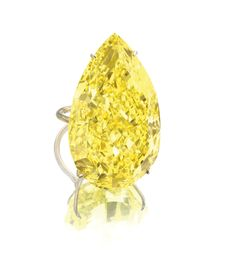 The Sun-Drop Diamond. This fancy vivid yellow pear-shaped diamond weighs 110.03 carats and is  mounted in yellow gold as a ring for presentation.