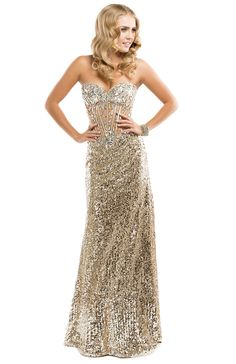 This sequined dress with an exposed boning bodice is your passport to a perfect prom night. | FLIRT Collection #eveningdress #gold #promdress