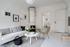A serene white and grey Swedish apartment // ceramic fireplace