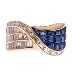 "Baguette Diamond & Blue Sapphire ""Mystery Curve"" Ring, Estate  A lovely choice for daily wear, this 18k yellow gold ring features an inspired design, with 15 mystery set sapphires and 36 baguette diamonds"