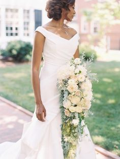An elegant wedding dress calls for an equally polished bouquet. For this bride, that meant a Passionflower arrangement made of garden roses, peonies, and dahlias plus a cascade of greenery. It surely turned heads at her Detroit museum wedding.