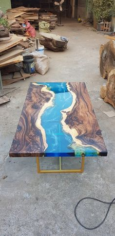 Blue river table top with epoxy inlay Senna siamea wood