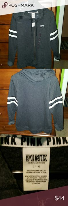 NWT PINK VS FULL ZIP HOODIE Super soft Hoodie. Pink logo on chest and top of hood. 2 White stripes with black outline on each arm. Fits true to size. Color is dark grey. PINK Victoria's Secret Sweaters