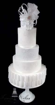 Paper & Lace Wedding Cake ~ Contemporary wedding cake decorated with wafer paper and cake lace detailing