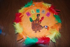Feathered Handprint Plate - Craft Fiesta #ThanksgivingCrafts Plate Crafts, Thanksgiving Crafts, Arts And Crafts, Plates, Diy, Craft Ideas, Decor, Fiestas, Licence Plates